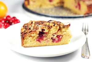 Low-carb, sugar-free almond cake with orange and cranberries